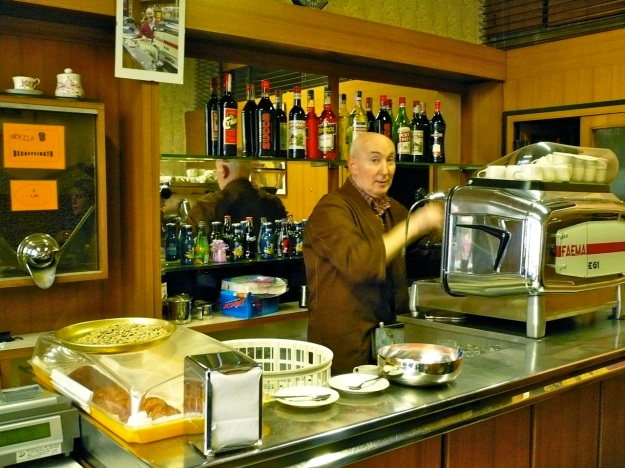 Old Barista in Milano working with his Faema E61