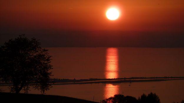 sunset bodensee with the bregenzer bucht and the rheindamm