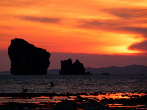 sunset thailand chicken island with swimmer