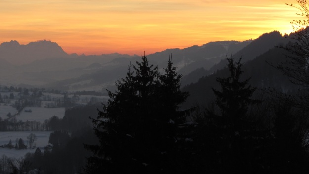 vintage ski race fischen allgaeu 2012 panorama with sunset and mountains
