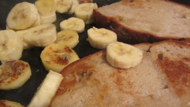 butter roasted bread with nutella and banana - brown the bread and heat the banana