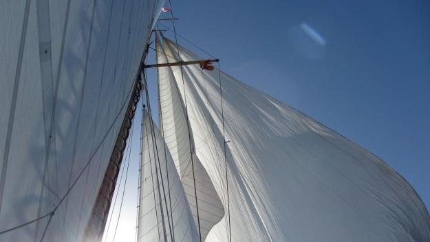 Moonbeam IV Yacht sails with sun