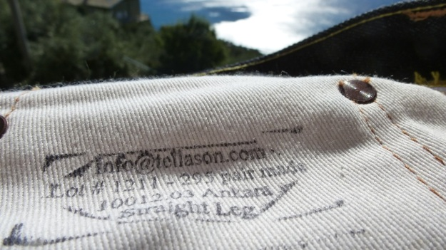 Tellason Ankara Jeans hand printed instructions on the pockets