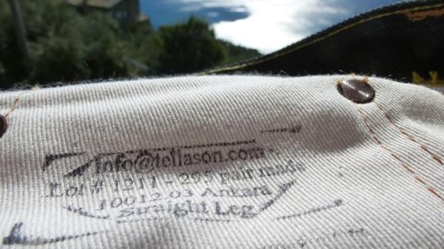 Tellason Ankara Jeans hand printed instructions on the pockets