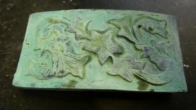 vintage US belt buckle from Amtraq beeing feinschmucked - rapidly vintaged green bronze
