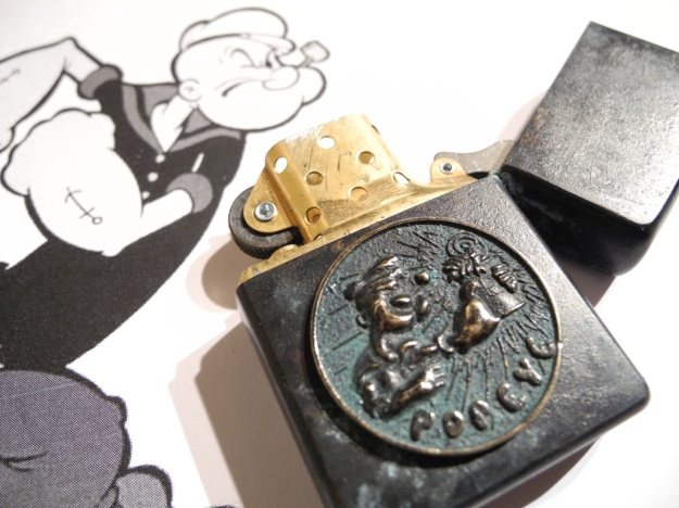 Popeye Zippo by Feinschmuck - brass aged greenish angeranzt