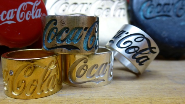 Coca Cola Belt Buckle and Ring collection by feinschmuck, silver, bronze and gold